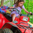 Stock Photo: Young Girl on 4-Wheeler ATV