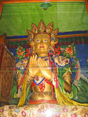 Ladakh, India, the Buddha in a monastery of Likir behind glass. — Stock Photo
