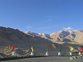 Ladakh, India, capital Leh, a protection with tags against mountains. — Stock Photo