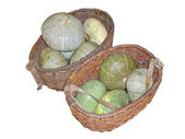 Pumpkins in old baskets, it is isolated, a white background. — Stock Photo
