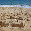 The sand lock constructed by the child, on the bank of the Atlantic ocean — Stock Photo
