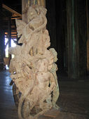 Sculptures in interior Buddhist wooden temple of True — Stock Photo
