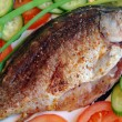 Fried fish the Crucian on a plate — Stock Photo