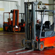 Stock Photo: Forklift in warehouse