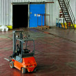 Forklift in warehouse - Stock Photo