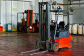 Forklift in warehouse — Foto Stock