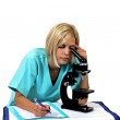 Doctor with microscope — Stock Photo