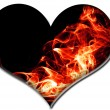 Royalty-Free Stock Photo: A heart with red fire flames