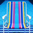 Swimming pool and deckchair — Stock Photo #3541724