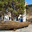 Old boat with a cypress in Portlligat, Cadaques, Spain — Stock Photo