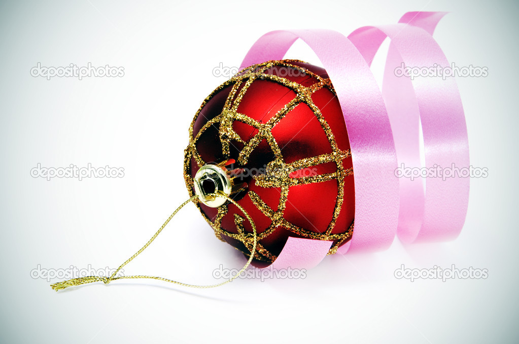 Red and golden christmas ball with a pink ribbon on a vignetting background  — Stock Photo #3744683