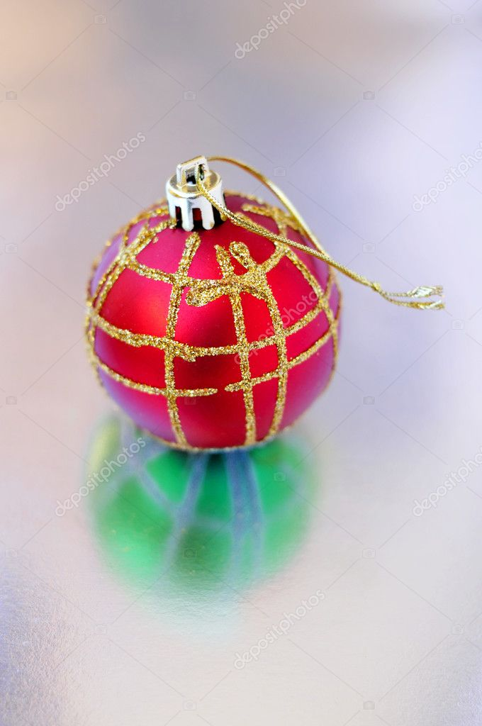 A red and golden christmas ball in a reflection background — Stock Photo #3802150
