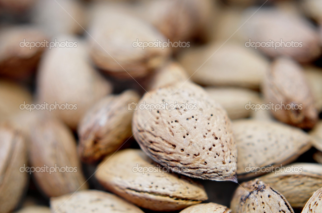 Closeup of a pile of almonds in shell — Stock Photo #3874974