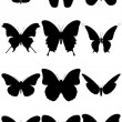 Vector illustration set of 12 butterfly silhouettes. — Stockvector