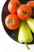 Tomatoes and peppers — Stock Photo