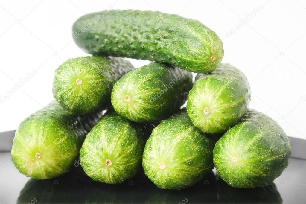 cucumbers placed in a black ceramic plate isolated on white background — Stock Photo #3615361