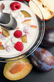 Yogurt mixed with fruit pieces — Stock Photo