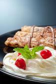 Pancakes with cream and chocolate. — Stock Photo