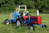 Two agriculture tractors — Stock Photo