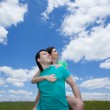 Loving dreamy couple on summer field looking up — Stock Photo