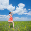 Happy smiling brunette woman enjoying wind wave outside - Stock Photo