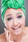 Happy smiling woman with green scarf on head — Stock Photo