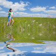 Stock Photo: Loving couple onfield embracing with reflection in the water