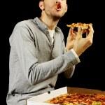 Tasty pizza and man — Stock Photo #3563539