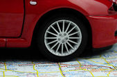 Wheel on the map — Stock Photo