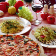 Royalty-Free Stock Photo: Classic Italian food setting with pizza, pasta, salad and wine