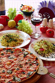 Classic Italian food setting with pizza, pasta, salad and wine — Stock Photo