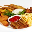 Stock Photo: Roasted fish and chicken wings served with french fries and rusks isolated