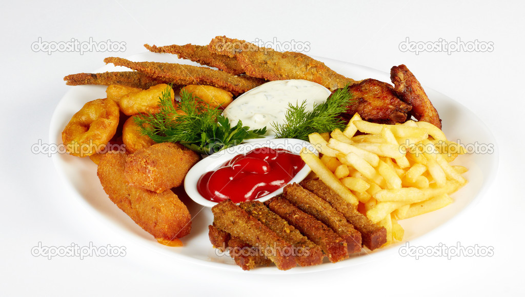 Roasted fish and chicken wings served with french fries for Fish and wings