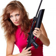 Sexy Action Girl with gun - Stock Photo