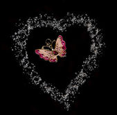 Butterfly in heart fron sugar in black background — Stock Photo