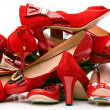 Pile of female red shoes isolated on white background — Stock Photo