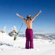 Female skier topless with a ski standing on the heel a back — Stock Photo #3529510