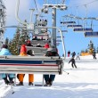 Stock Photo: Skiers go on the lift on mountain in Bukovel, Ukraine