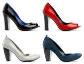 Four female high-heeled shoes — Stock Photo