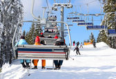 Skiers go on the lift on mountain in Bukovel, Ukraine — Stock Photo