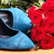 Stock Photo: Closeup of pair of blue female shoes and red roses