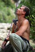 Belayer watching lead climber — Stock Photo