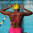 Female swimmer in front of pool. — Stock Photo