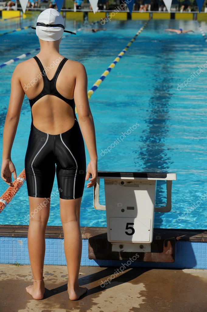 A female relay swimmer waits for her turn to start during a competition. — Photo #3528167