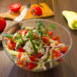 Salad in glass dish in the kitchen — Stock Photo