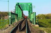 Train bridge on river Koros — Stock Photo