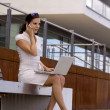Business female working outside - Stock Photo