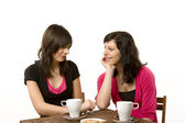 Two females drinking coffee and talk — Stock Photo