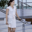 Business female on stairs — Stock Photo