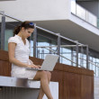 Stock Photo: Business female on stairs